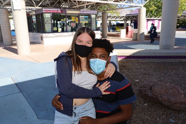 woman hugging teen