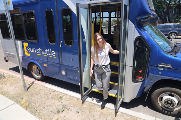 woman exiting sunshuttle